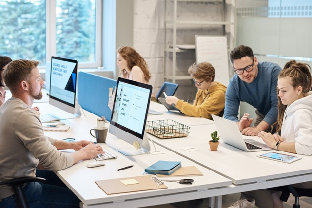 people-working-in-front-of-the-computer-3184357